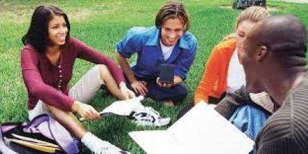 The image showing the showing students learning the French language among themselves