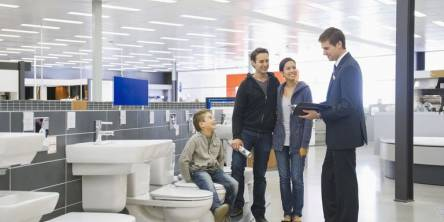 family shopping for a toilet