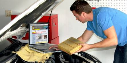 car repair pro looking into the car's hood