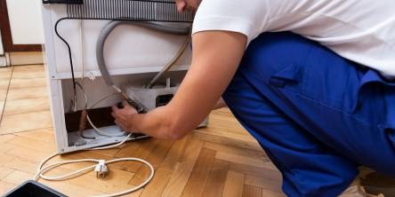 appliance repiar pro fixing refrigerator leak