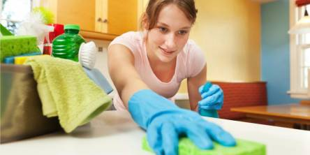 housekeeper wiping down the counters