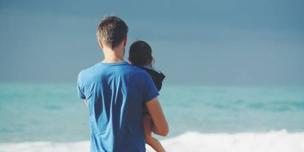 Man and daughter on the beach