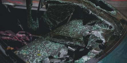 The smashed front windows of a car after an accident.