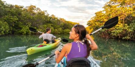 couple kayaking together in mangrove river