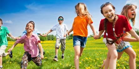 happy children running in the grass