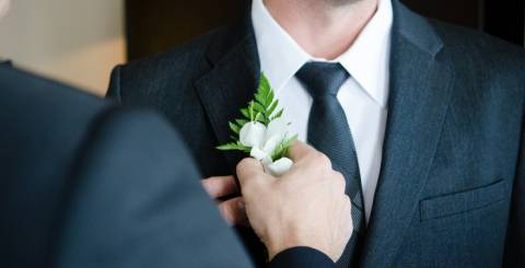 Groom being given flower