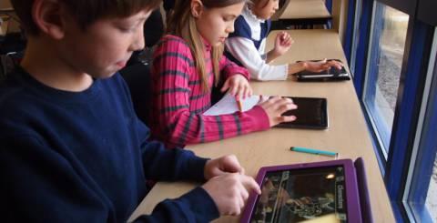 Children Using iPads at School