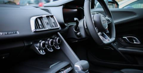 The interior of a car with right hand side driving.