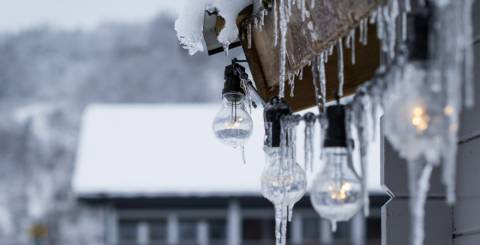 Icicles hanging from the roof of a house,