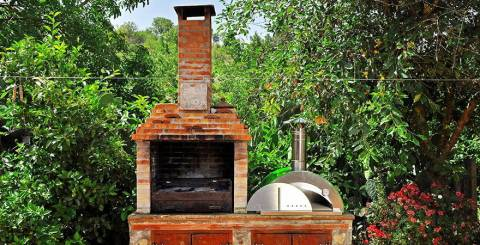 Red Brick Pizza Oven With Chimney In Garden
