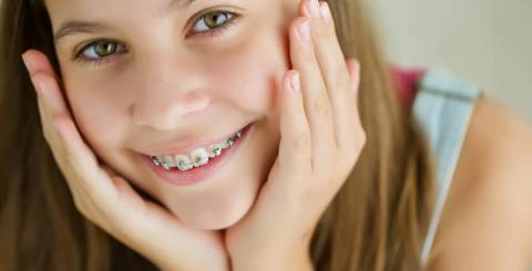 How to Help Your Kid Get Used to and Look After Their Braces