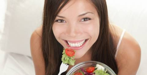 Happy Woman Eating Salads